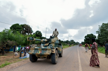 occurs: Kartiak,Senegal-September 18,2012 : military tank patrols in the streets in the ritual of Boukoutt of Initiation ceremony on September 18, 2012 in Kartiak, Senegal. The ceremony occurs every 30 years and celebrates boys becoming men.