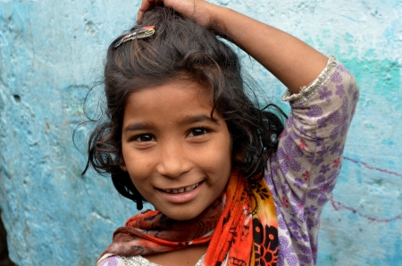 slums: New Delhi,India-February 4, 2013:An unidentified child lives in the slums of New Delhi Editorial