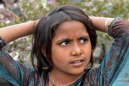 slums: New Delhi,India-February 4, 2013:An unidentified child lives in the slums of New Delhi.