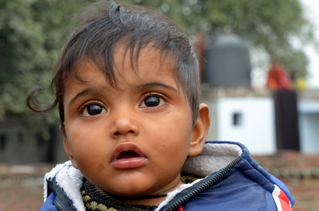 child poverty: New Delhi,India-February 4, 2013:An unidentified child lives in the slums of New Delhi Editorial