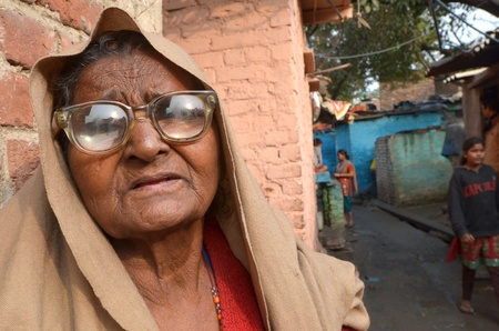 poor people: New Delhi,India-February 4, 2013:Portrait of a elderly woman near his home located in the poor neighborhood of New Delhi