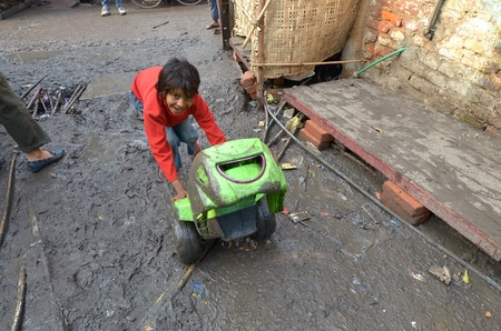 new delhi: New Delhi,India-February 4, 2013:a  unidentified child playing the poorest district of New Delhi