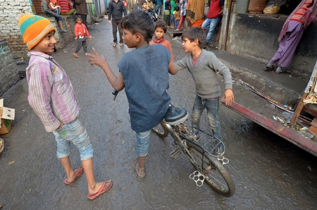 poor children: New Delhi,India February 4, 2013: a unidentified children playing in the poorest district of New Delhi  Editorial