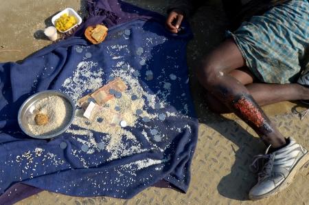 mendicant: begging child