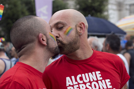 bisexuals: MILANO-ITALY,JUNE 28,2014 An unidentified gays kissing during in eleventh Pride Week Day  Crowd of people participate in the eleventh parade celebrates gays, lesbians Editorial