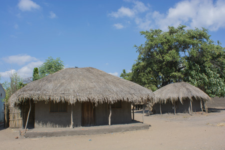 thatched house: typical African house with a thatched roof Stock Photo
