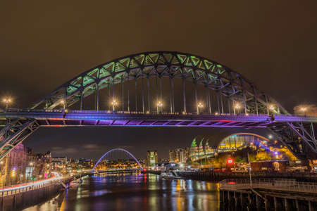 Newcastle Quayside at night with reflections in the river