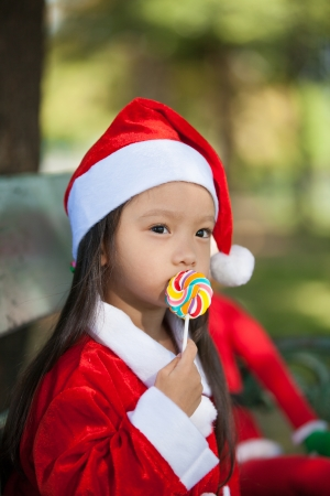 Little girl enjoy dressing as santa photo