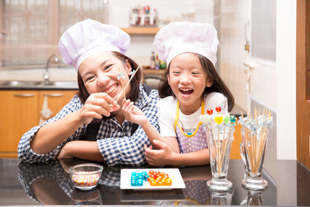 Mother and daughter making jelly ball in the kitchen Stock Photo