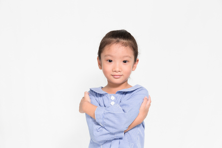 proudly: little asian girl posing proudly on isolated white background