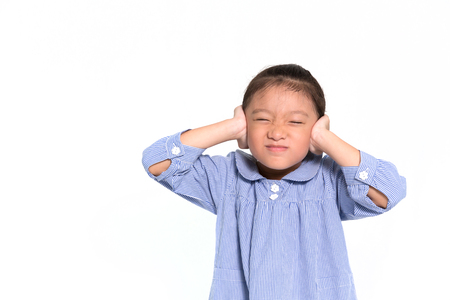 be alert: Little asian girl angry and put hand closing her ears isolate on white background