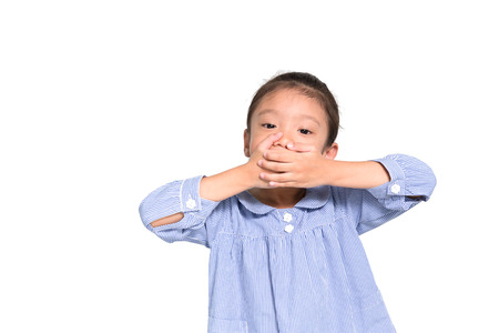 frustrate: Little asian girl put hand closing her mouth isolated on white background Stock Photo