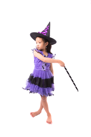 Little witch girl costume posing for halloween isolated on white background,Halloween costume girl posing isolated on white background Stock Photo