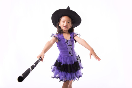 esoterism: Little witch girl costume posing for halloween isolated on white background,Halloween costume girl posing isolated on white background Stock Photo