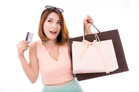 happy asian people: Asian girl enjoy shopping with credit card and shopping bag isolate on white background, Shopping girl isolate on white background