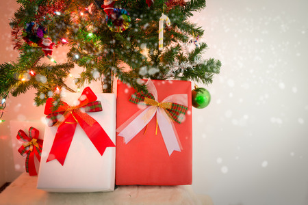 christmas gift box and decorated christmas tree in warm tone photo stock photo 68867260