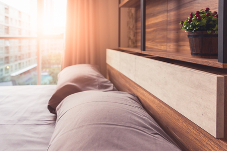 Bed room in condominuim or apartment in morning time, concept of city life Stock Photo