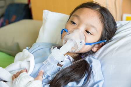 Girl patient treating and healing with respiratory mask equipment Stock Photo - 95980845