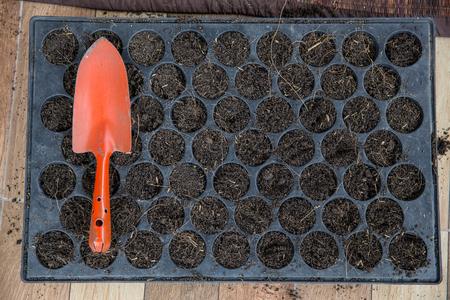 Shovel on planting trays