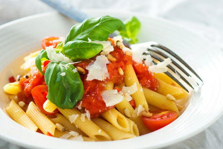 tomato: Pasta with tomato and fresh basil Stock Photo