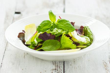 cruciferous: Summer leaf salad on a wooden background