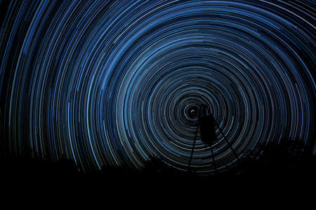 long exposure: Long exposure of stars creating star trails (Stacked photos)