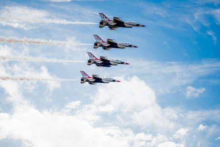 united states air force: San Antonio, Texas - October, 31: United States Air Force F-16 Thunderbirds in formation above the clouds