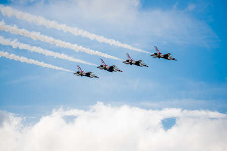 united states air force: San Antonio, Texas - October, 31: United States Air Force F-16 Thunderbirds in formation over the clouds