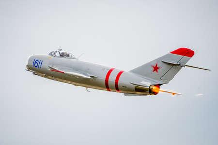 afterburner: SAN ANTONIO, USA - October 31, 2015: Mig-17 Jet Flying Away with afterburner Editorial