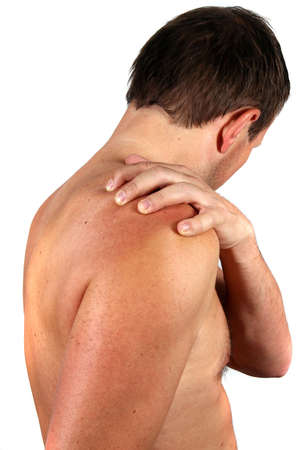 Pain In The Shoulder - A young man is holding his shoulder in pain! Isolated over white.