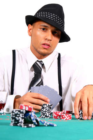 card player: Cool Card Player - Young man playing poker with a hat and stylish suit. Isolated over white background.