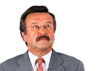Senior Businessman Looking Up - A businessman in his sixties with glasses a suit and a mustache looking up. Isolated over white. Stock Photo - 3765850