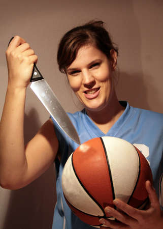 stab: No More Sports - an angry woman trying to stab a basketball.