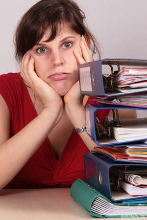 piling: Work Please Stop - a young beautiful woman is stressed because of the work piling up.