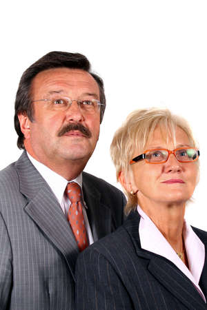 Business Team In Their 50S - A senior business couple in suits in their 50s and 60s. Isolated over white.  photo
