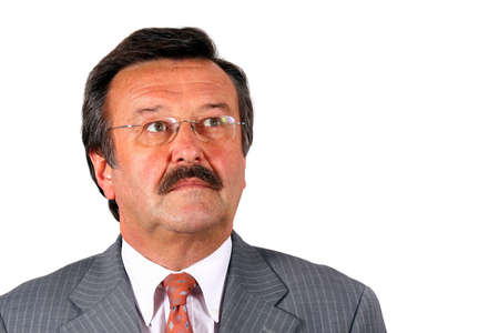 Senior Businessman Looking Up - A businessman in his sixties with glasses a suit and a mustache. Isolated over white.  Stock Photo - 3784280