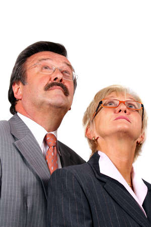 Mature business team - A mature business couple looking up. Isolated over pure white. photo