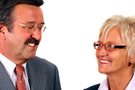 Mature Businesspeople - A business woman and a man looking at each other. Isolated over white. Stock Photo - 3793178