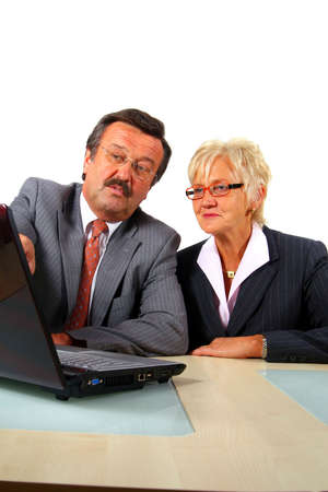 Manager And Secretary - A senior businessmanager explains stats to his secretary. Isolated over white. Business shot. Stock Photo - 3833447