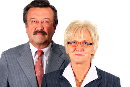 ceos: Fresh Business Ceos - A senior business couple in suits in their 50s and 60s. Isolated over white.