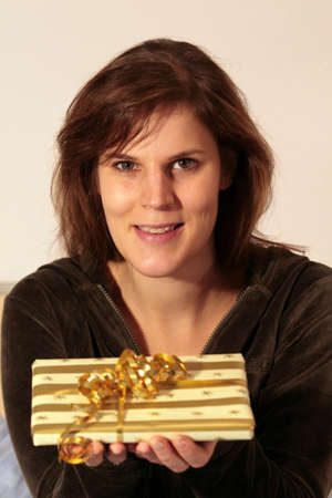 Woman And Gift - a young woman with a gift in her hands. photo