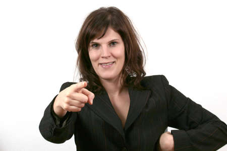 We Want You - a young beautiful business woman is pointing at you. photo