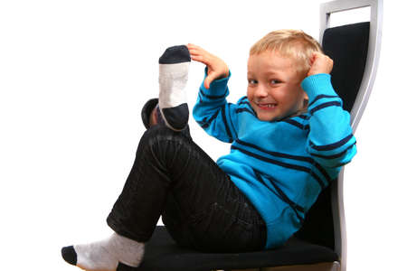 Young Boy - A young happy boy on a chair. Isolated over white. Stock Photo - 3903672