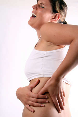 For Crying Out Loud! - A young woman holds her back in pain! Stock Photo - 3940414