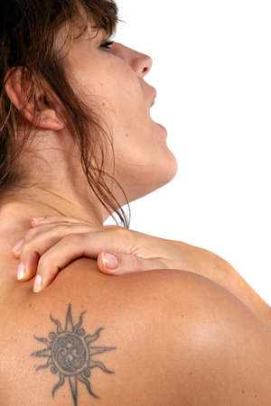 Pain In The Shoulder - A young woman screams in pain and holds her shoulder. Stock Photo - 3940421