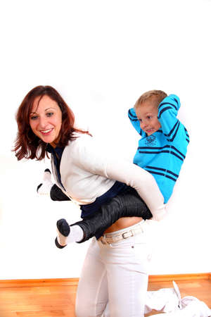 Young Family - A mother and her son having fun. Isolated over white. Stock Photo - 3978810