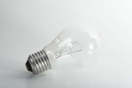 Light Bulb - A light bulb on a light grey background. Stock Photo - 4006958