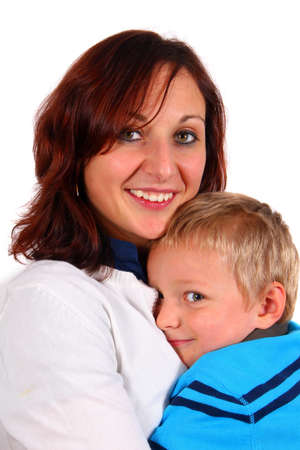 Cuddling With Mommy - A single mother with her young son. Isolated over white.  photo