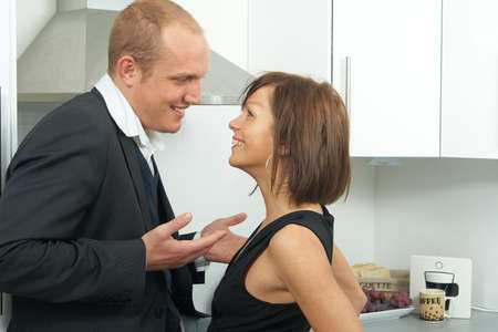 A young business couple talks in the kitchen. Stock Photo - 3997171