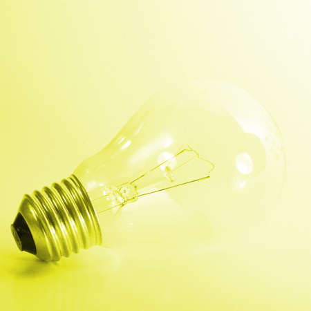 A light bulb on a yellow background. Stock Photo - 4040226